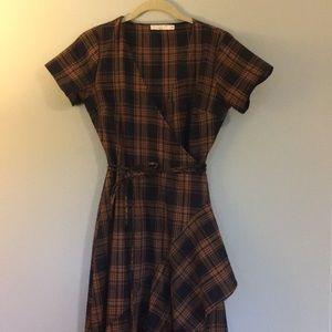 Orange and black plaid hi-low wrap dress